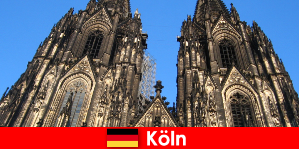 German family vacationers with children like to travel to the city of Cologne
