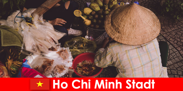 Foreigners try the variety of food stalls in Ho Chi Minh City Vietnam