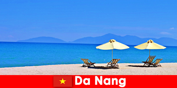 Package tourists relax on the azure blue beaches in Da Nang Vietnam