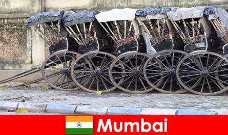 Mumbai in India offers rickshaw rides through crowded streets for the travel enthusiast