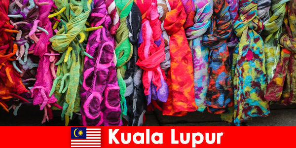 Cultural tourists in Kuala Lumpur Malaysia experience the excellent craftsmanship